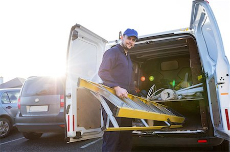 services - Portrait of handyman loading a ladder Stock Photo - Premium Royalty-Free, Code: 6109-08537544