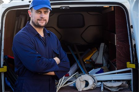 services - Portrait of handyman standing with arms crossed Stock Photo - Premium Royalty-Free, Code: 6109-08537545