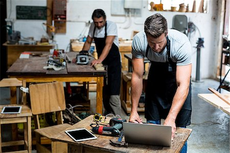 professional (pertains to traditional blue collar careers) - Two carpenters working in workshop Stock Photo - Premium Royalty-Free, Code: 6109-08538013