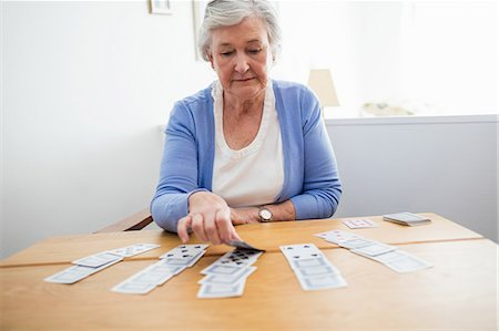 Senior woman playing cards Stock Photo - Premium Royalty-Free, Code: 6109-08538224