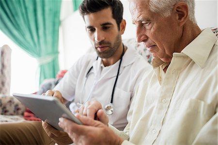 Nurse and senior man using tablet Stock Photo - Premium Royalty-Free, Code: 6109-08538374