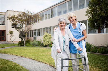 Nurse helping senior woman walking Stock Photo - Premium Royalty-Free, Code: 6109-08538387
