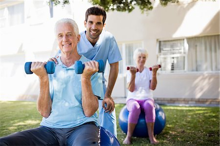 Senior couple doing exercises Stock Photo - Premium Royalty-Free, Code: 6109-08538397