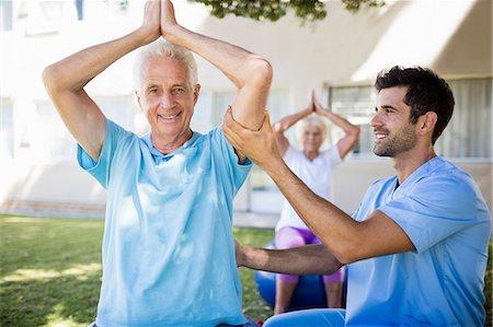 Senior couple doing exercises Stock Photo - Premium Royalty-Free, Code: 6109-08538399