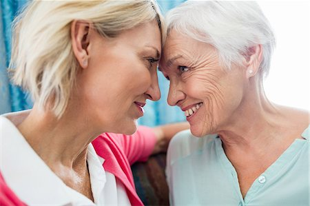 Nurse taking care of a senior woman Stock Photo - Premium Royalty-Free, Code: 6109-08538312