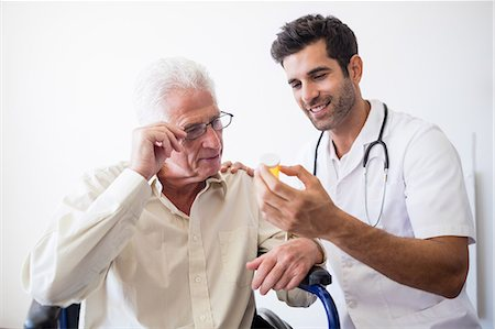 Nurse giving pills to senior man Stock Photo - Premium Royalty-Free, Code: 6109-08538336