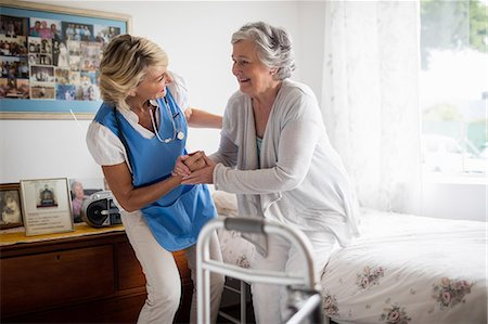 Nurse posing with a senior woman Stock Photo - Premium Royalty-Free, Code: 6109-08538447