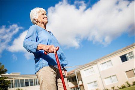 A senior woman walking with her walking stick Stock Photo - Premium Royalty-Free, Code: 6109-08538457