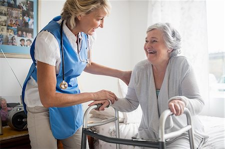 senior women - Nurse helping senior woman to stand up Stock Photo - Premium Royalty-Free, Code: 6109-08538472