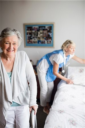 Nurse and senior woman are posing Stock Photo - Premium Royalty-Free, Code: 6109-08538477