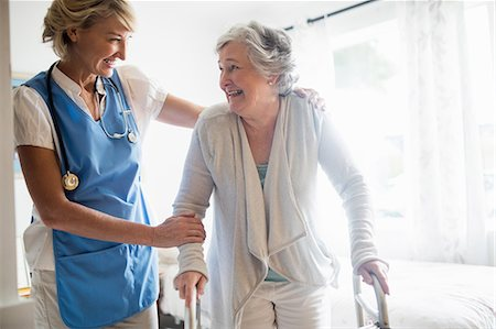 Nurse helping senior woman to stand up Stock Photo - Premium Royalty-Free, Code: 6109-08538474