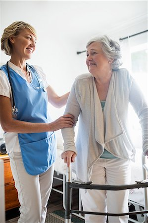 Nurse helping senior woman to stand up Stock Photo - Premium Royalty-Free, Code: 6109-08538475