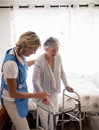 Nurse helping senior woman to walk Stock Photo - Premium Royalty-Free, Code: 6109-08538479