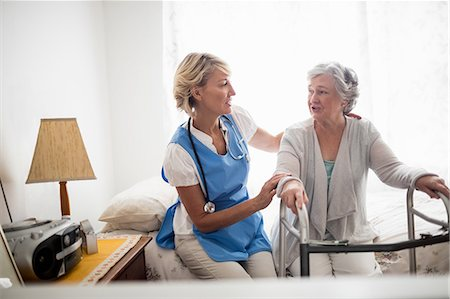 Nurse helping senior woman to stand up Stock Photo - Premium Royalty-Free, Code: 6109-08538480