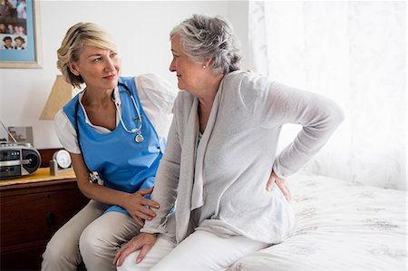 Nurse helping senior woman to stand up Stock Photo - Premium Royalty-Free, Code: 6109-08538484