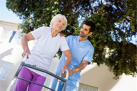 Nurse helping senior woman to walk Stock Photo - Premium Royalty-Free, Code: 6109-08538414