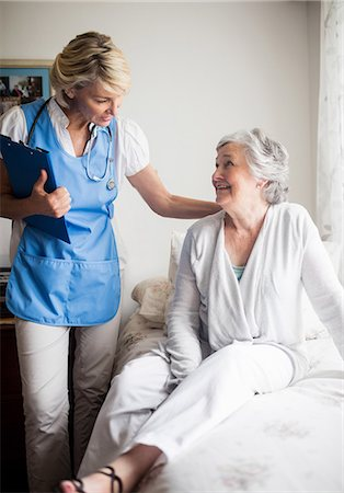 Nurse speaking with a senior woman Stock Photo - Premium Royalty-Free, Code: 6109-08538421