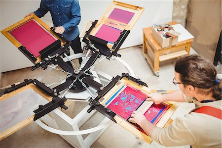 Craftsmen painting on wood in workshop Stock Photo - Premium Royalty-Free, Code: 6109-08689626