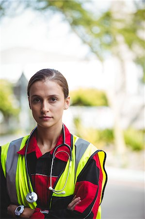 Portrait of a stern ambulance woman with arm crossed Stock Photo - Premium Royalty-Free, Code: 6109-08689795