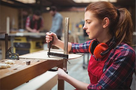 Female carpenter working in workshop Stock Photo - Premium Royalty-Free, Code: 6109-08689937
