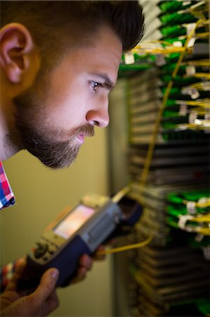 Close-Up of technician using digital cable analyzer in server room Stock Photo - Premium Royalty-Free, Code: 6109-08690115