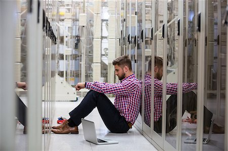 Technician feeling the pressure in server room Stock Photo - Premium Royalty-Free, Code: 6109-08690130