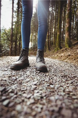 focused on woman legs on the path of the wood Stock Photo - Premium Royalty-Free, Code: 6109-08690481