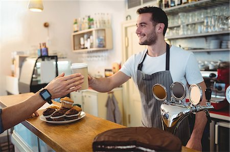 shop - Happy young male barista serving coffee to customer at cafe Stock Photo - Premium Royalty-Free, Code: 6109-08690404