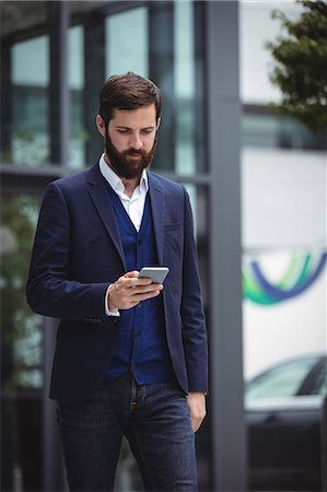 dependable - Businessman using mobile phone outside office Stock Photo - Premium Royalty-Free, Code: 6109-08763964