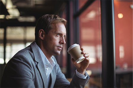 simsearch:6109-08700445,k - Thoughtful businessman having coffee in café Stock Photo - Premium Royalty-Free, Code: 6109-08765116