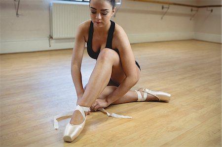 Ballerina wearing ballet shoes in the studio Stock Photo - Premium Royalty-Free, Code: 6109-08782828