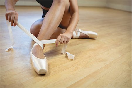 Ballerina wearing ballet shoes in the studio Stock Photo - Premium Royalty-Free, Code: 6109-08782829