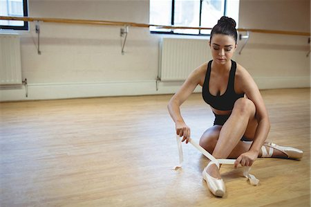 Ballerina wearing ballet shoes in the studio Stock Photo - Premium Royalty-Free, Code: 6109-08782831