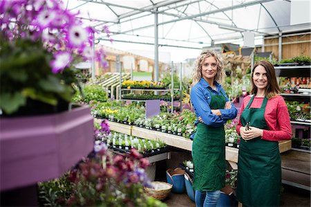 Portrait of two female florist smiling in garden centre Stock Photo - Premium Royalty-Free, Code: 6109-08701270