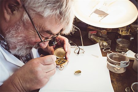 Horologist repairing a pocket watch in the workshop Stock Photo - Premium Royalty-Free, Code: 6109-08705180