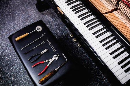 Close-up of repairing tools and old piano keyboard Stock Photo - Premium Royalty-Free, Code: 6109-08720462