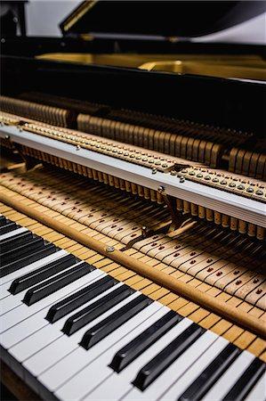 Close-up of old piano keyboard at workshop Stock Photo - Premium Royalty-Free, Code: 6109-08720468