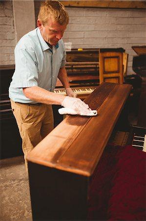 Piano technician repairing the piano at workshop Stock Photo - Premium Royalty-Free, Code: 6109-08720474