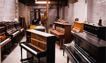 Pianos arranged in workshop Stock Photo - Premium Royalty-Free, Code: 6109-08720479
