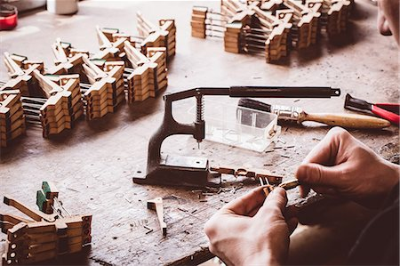 Piano technician working on piano parts at workshop Stock Photo - Premium Royalty-Free, Code: 6109-08720480