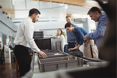 Passengers in airport security check at airport Stock Photo - Premium Royalty-Free, Code: 6109-08722593