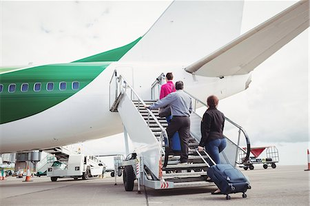 Passengers climbing on the stairs and entering into the airplane at airport Stock Photo - Premium Royalty-Free, Code: 6109-08722689