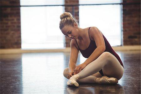 Ballerina wearing ballet shoes in the studio Stock Photo - Premium Royalty-Free, Code: 6109-08802197