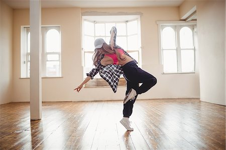 Pretty woman practising hip hop dance in studio Stock Photo - Premium Royalty-Free, Code: 6109-08802652