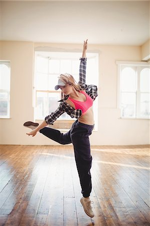 Young woman practising hip hop dance in studio Stock Photo - Premium Royalty-Free, Code: 6109-08802676