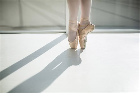 solid - Close up of feet of young ballerina Stock Photo - Premium Royalty-Free, Code: 6109-08803097