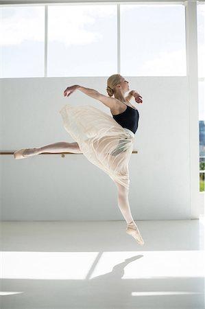Ballerina practicing a ballet dance in ballet studio Stock Photo - Premium Royalty-Free, Code: 6109-08803031