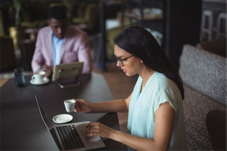 simsearch:6109-08700445,k - Businesswoman using laptop in office Stock Photo - Premium Royalty-Free, Code: 6109-08805161