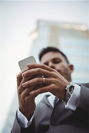 scroll - Businessman using mobile phone Stock Photo - Premium Royalty-Free, Code: 6109-08830057