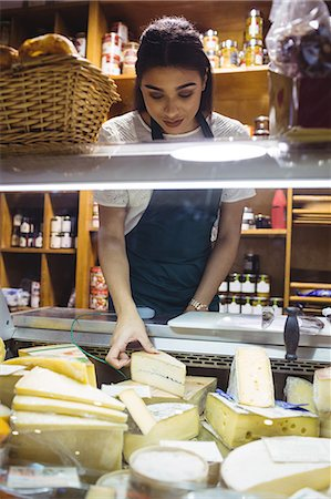 shop - Female staff working at cheese counter Stock Photo - Premium Royalty-Free, Code: 6109-08830367